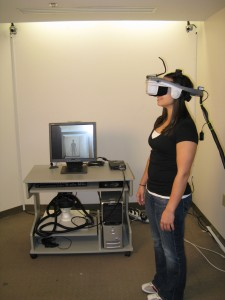 A fully immersive environment. The user is in a head-mounted display (HMD) and can only see the virtual world, which changes naturally as she moves.
